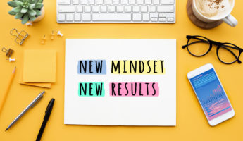 New mindset new results concepts with text on notepad on desk. positive thinking and motivation of business.