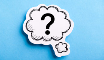 Question Mark speech bubble isolated on blue background.